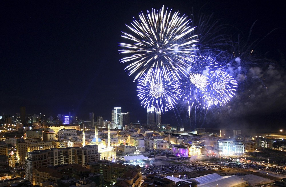 Fireworks explode during New Year's Eve celebrations in downtown Beirut