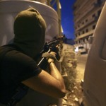 A Lebanon's Hezbollah gunman fires during clashes at Burj Abi Haidar street in Beirut