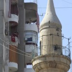 A damaged minaret of al-Ahbash mosque is seen after clashes at Burj Abi Haidar street in Beirut