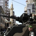 Lebanese soldiers on an armoured personnel carrier secure the area in front of al-Ahbash mosque after clashes at Burj Abi Haidar street in Beirut